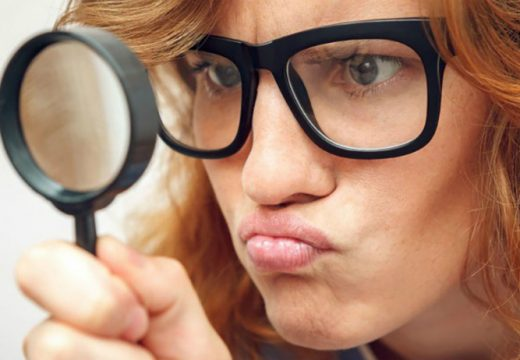 woman-with-magnifying-glass-750