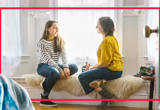 mother-teenage-daughter-talking-on-sofa